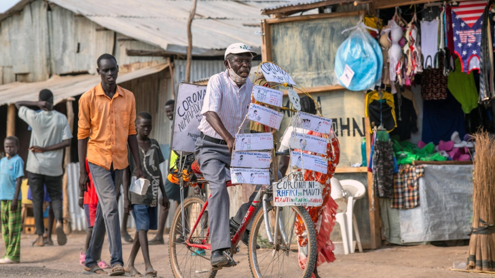 With churches closed in Kenya's Kakuma refugee camp, Djuba Alois, a 75-year-old pastor, is using his bicycle to preach to his flock and share information about COVID-19.
