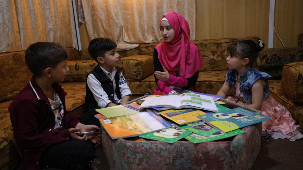While schools have been closed in Jordan's Za'atari refugee camp, 14-year-old Syrian refugee Sidra Median Al-Ghothani has been helping her younger brother and her neighbour's children to study at home.