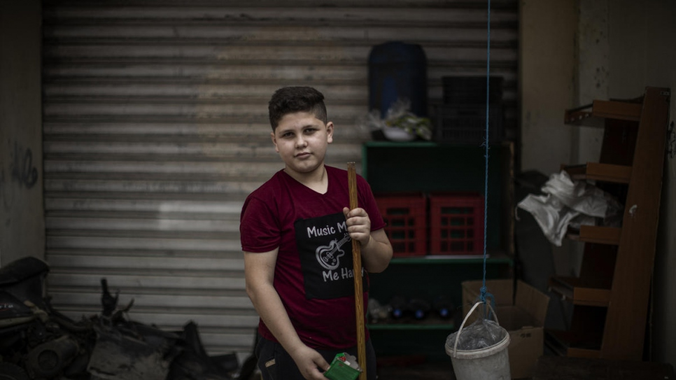 Thirteen-year-old Syrian refugee Bakr works in a supermarket and delivers food to support his family.