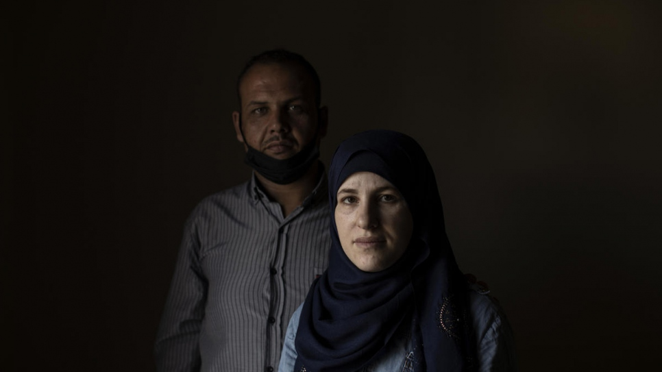 Wafaa, 32, and her husband Mohammad, 37, have their portrait taken at home in Barja, Lebanon.