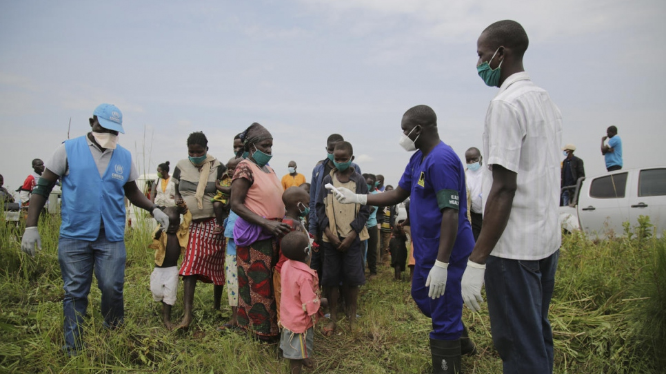 Congolese refugees and asylum-seekers undergo health screening near the border in Zombo, Uganda, as one measure to prevent the spread of COVID-19 there.