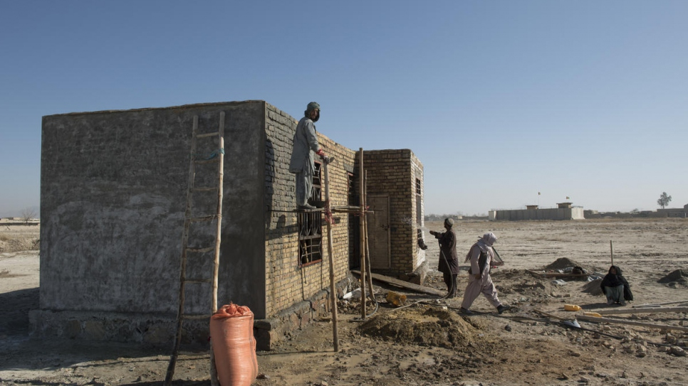 Construction work on a house in the Dand district of Kandahar province that was built with the support of UNHCR's Cash for Shelter project (3 February, 2020).