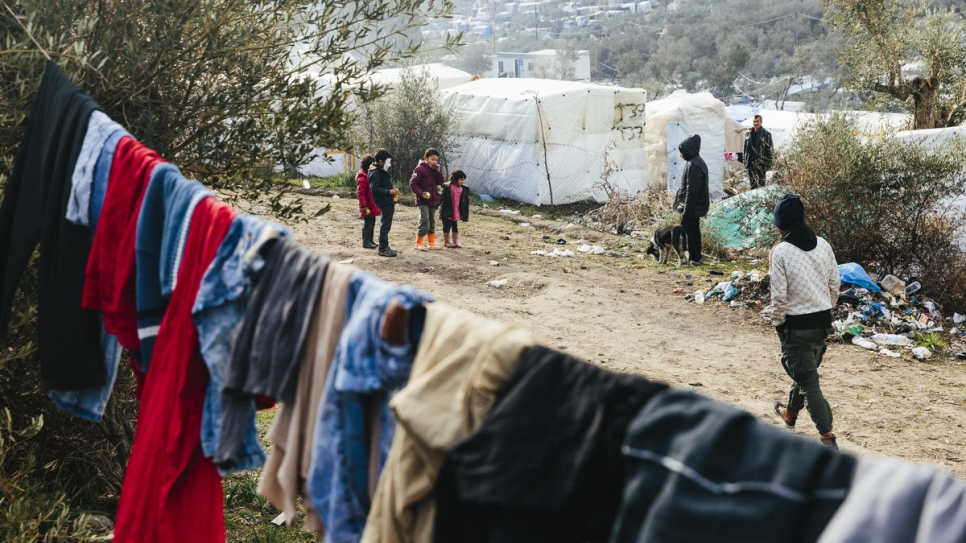 A group of young children play at a makeshift camp adjacent to the Moria reception and identification centre on the Greek island of Lesvos.
