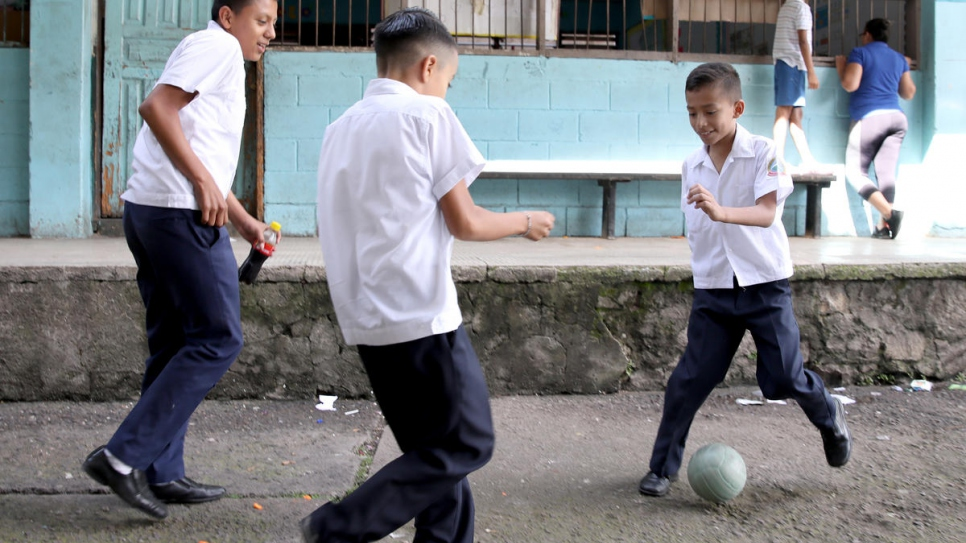 Gangs in Honduras prey on vulnerable youths, recruiting them to be used as foot soldiers in their criminal operations. Here, schoolboys are at play in Tegucigalpa in November, 2019.