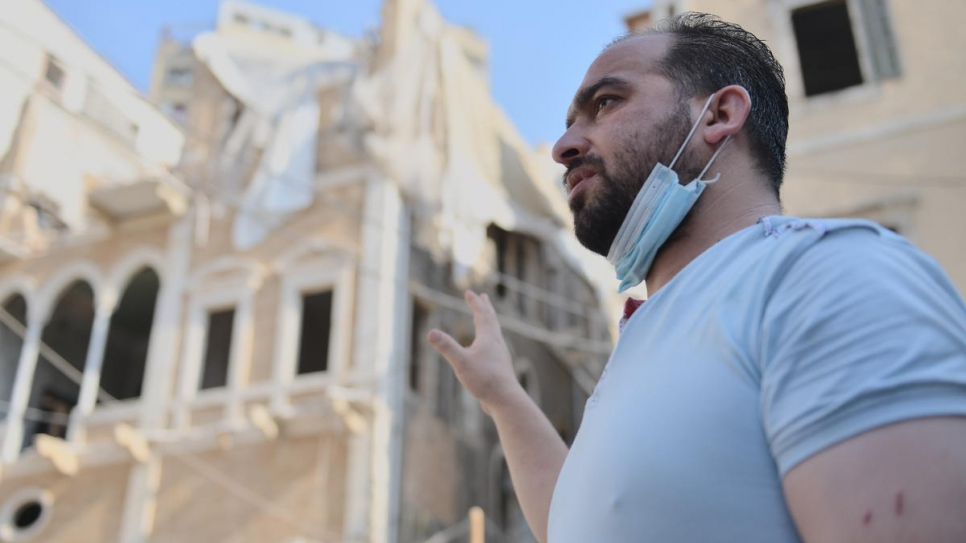 Syrian refugee Ahmed Kallout stands in front of the house in Beirut where he lived with his family and worked as a concierge. His wife and two sons were injured in the 4 August blast.