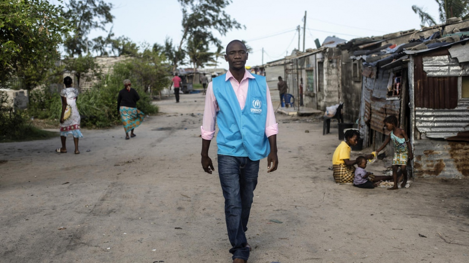 Luis Jose Faife walks in the streets of a settlement in Beira that was devastated by cyclone Idai last year.