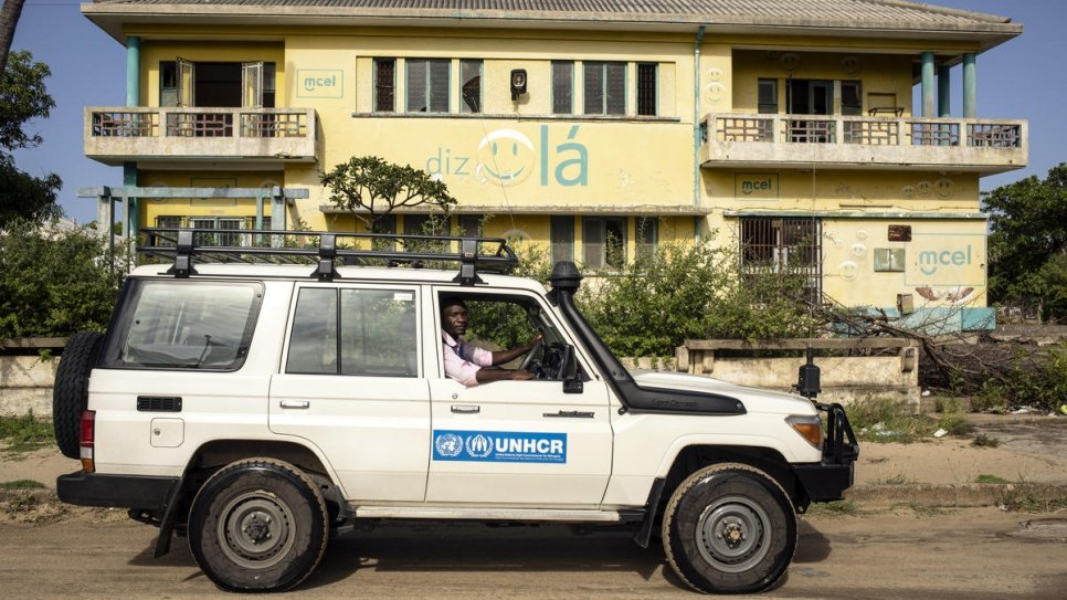 Luis Jose Faife sits in his UNHCR vehicle in Beira, Mozambique.
