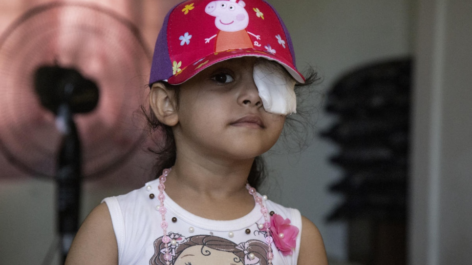 Sama wears a patch over her left eye after it was injured in the explosion.