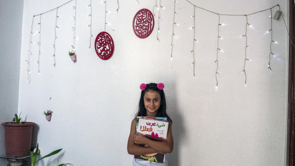 Eight-year-old Syrian refugee Rama Al-Lemoni is photographed after being read a story by a We Love Reading ambassador in Amman.