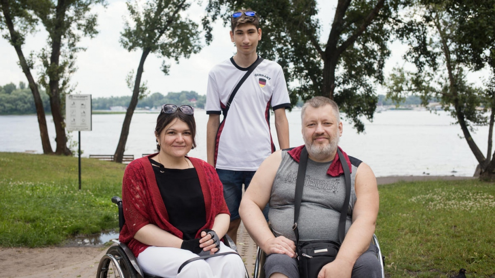 Tetiana Baransova, Nansen Refugee Award regional winner for Europe, with husband Oleksiy Soroka and son Pavlo, at Pavlo's birthday party in Natalka Park, Kyiv, Ukraine.
