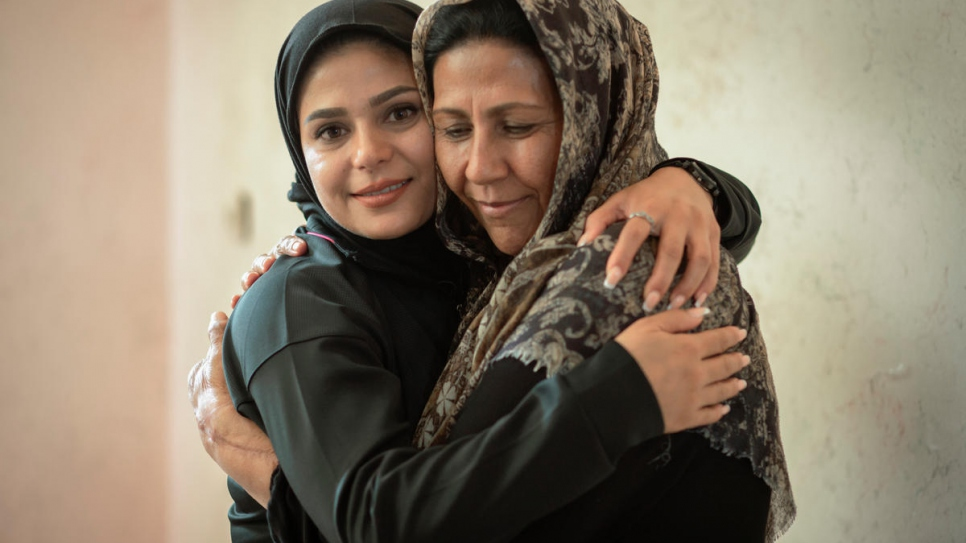 Rozma hugs her mother, Pari, at her home in Shiraz.