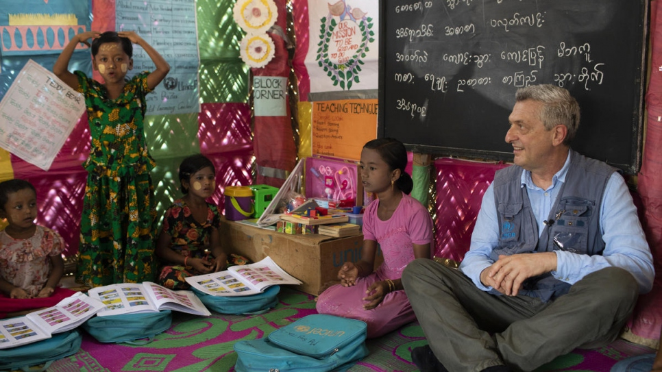 UN High Commissioner for Refugees Filippo Grandi met Myshara (in pink), and other children in the group she leads, at a learning centre in Kutupalong camp in April 2019.