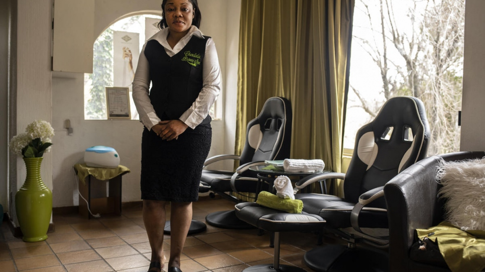 Congolese refugee Michelle, stands in her beauty salon in Pretoria, South Africa.