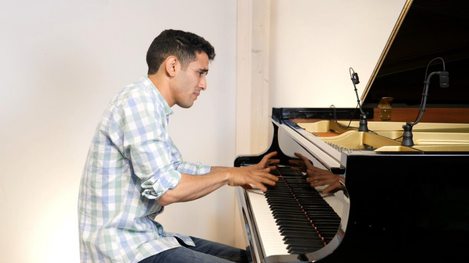 "Aeham Ahmad, the ""Pianist of Yarmouk,"" recording his Nansen performance in Kassel, Germany."