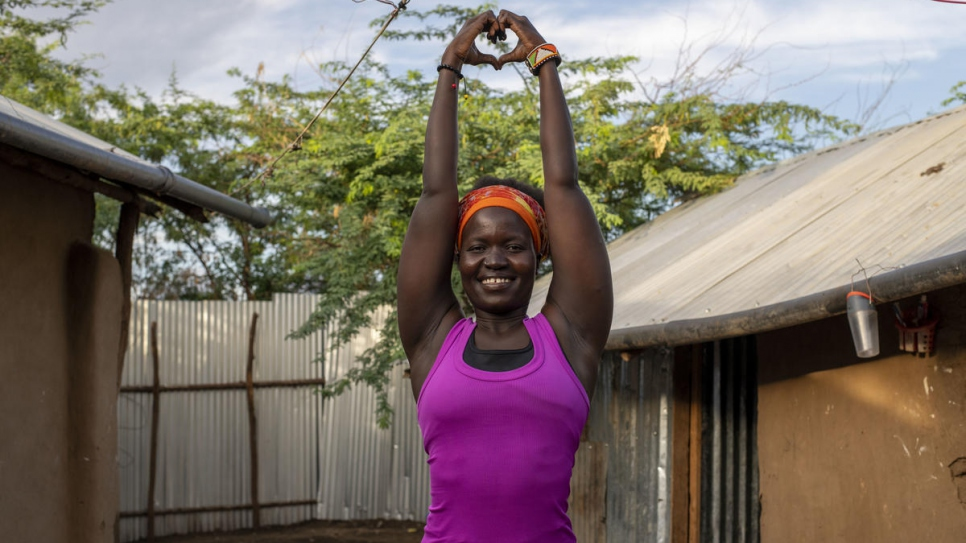 Rita Brown, a Ugandan refugee and yoga instructor, strikes a pose in her compound at Kakuma camp, Kenya. She gives online classes that help refugees and others deal with stress.