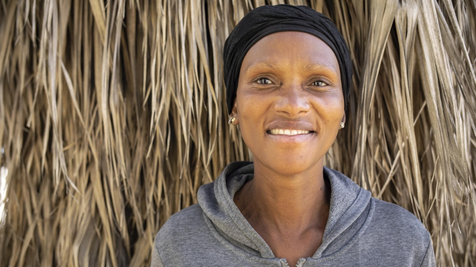Regina, a South African beneficiary of food parcels distributed by the Somali business community, poses in Pretoria, South Africa.