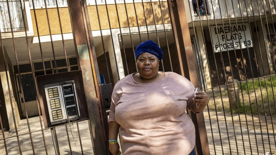 South African volunteer Désirée Booysen leaves her building in Pretoria to distribute food to people on the streets and in community centres.