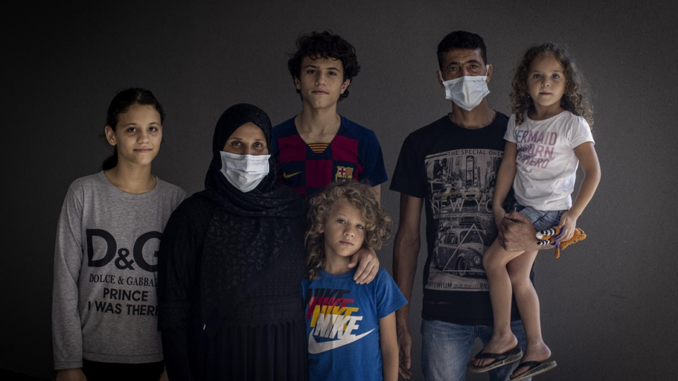 Manar (far right) poses for a family portrait with (from left to right), her sister Iman, 13, mother Fahima, 35, brothers Jamal, 15, and Mahmoud, 8, and father Mohammad, 39.