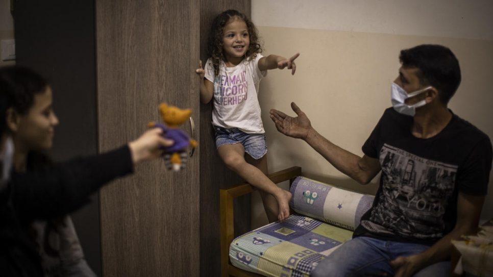 Manar plays with her father Mohammad at their home in Beirut, Lebanon.