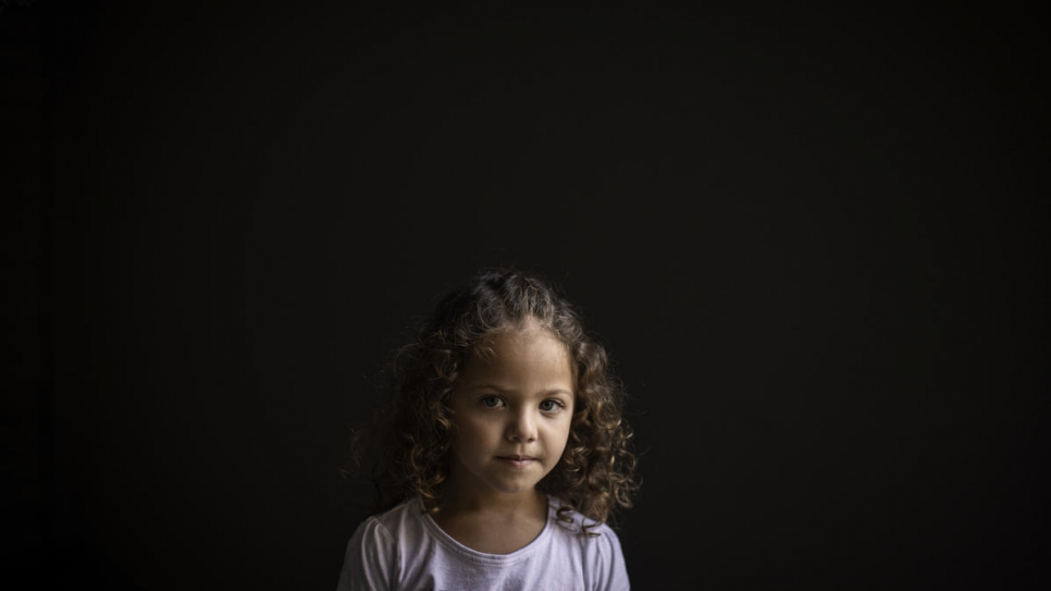 Four-year-old Syrian refugee Manar is photographed at her home in Beirut, Lebanon.