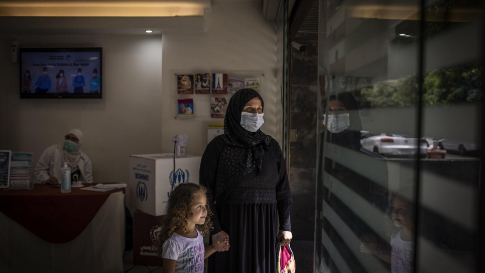 Manar and her mother Fahima leave the Makhzoumi Foundation clinic in Beirut after a psychological support session.