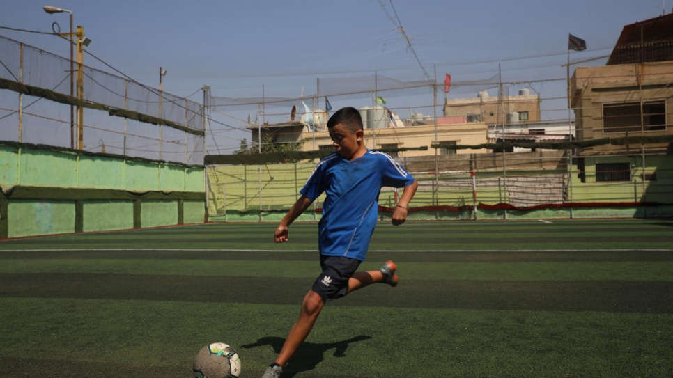 Syrian refugee Ghaith, 13, trains on the pitch at his local youth club in Beirut.