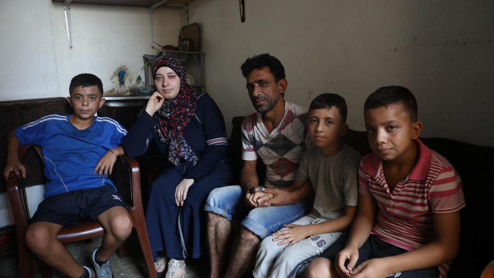 The family are pictured in their former apartment in the Jnah neighbourhood of the Lebanese capital.