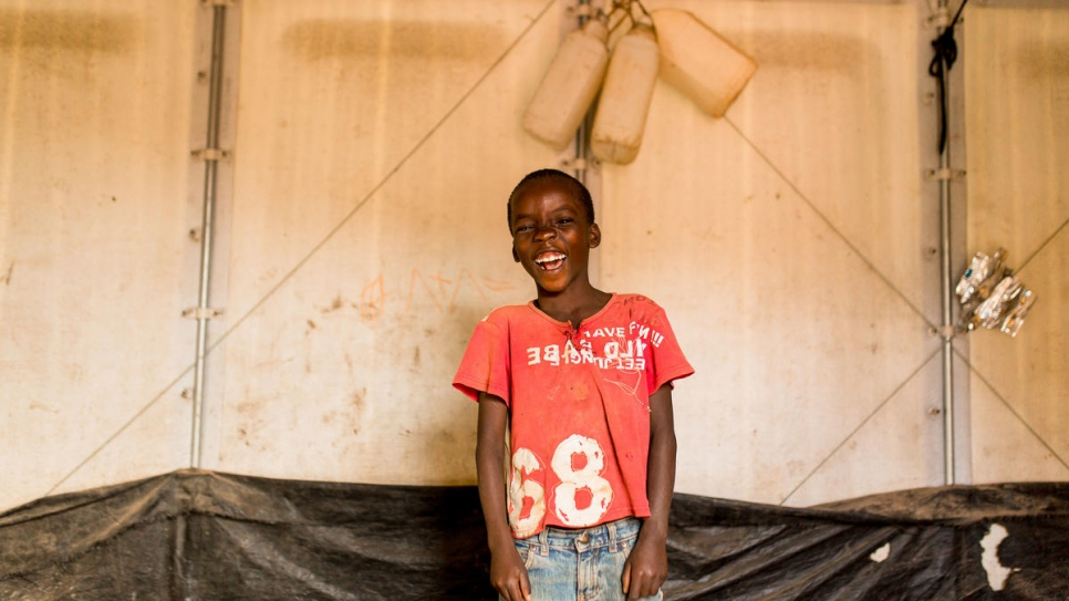 A child laughs at Kigoma refugee camp in Tanzania.