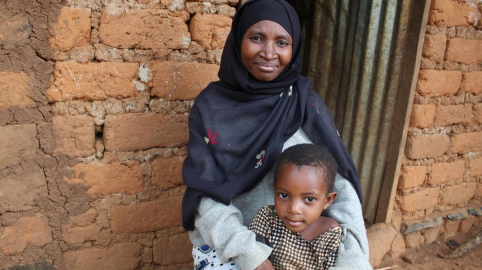 Burundian refugee Venancia Nibitanga, sits with her youngest daughter outside her home in Nduta refugee camp, Tanzania.
