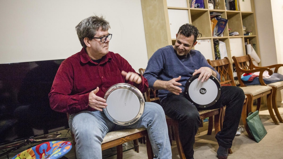 Hani Arnout (right), 34, plays drums with Steve Chapman, at the Arnout home in Ottery St Mary, Devon, south-west England. Hani and Steve have built up a friendship around a shared love of drumming.