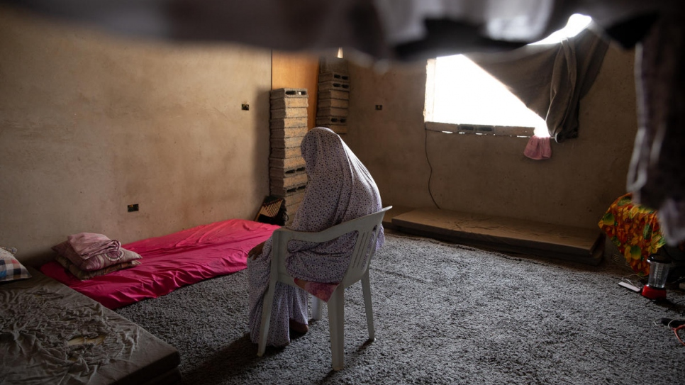 Hanan is photographed praying at her temporary home in the Libyan capital Tripoli.