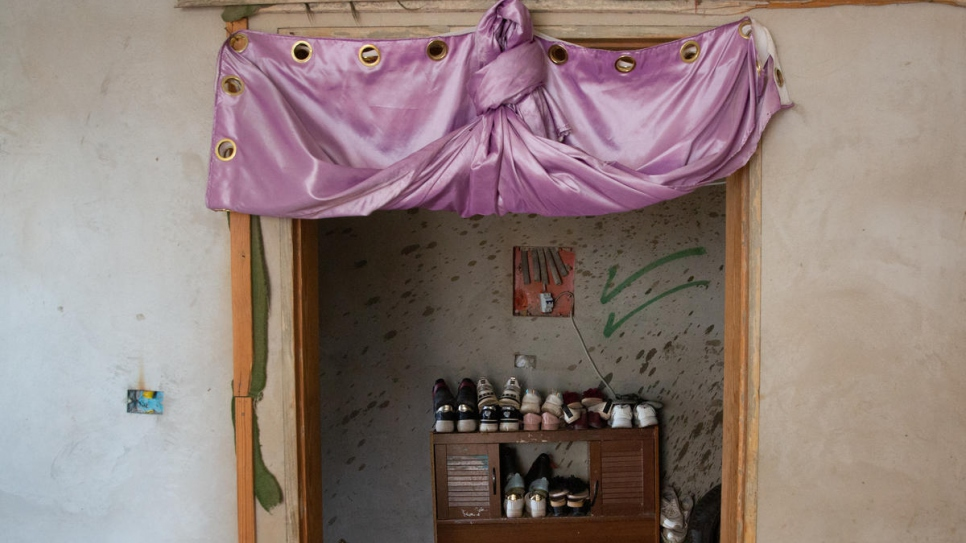 Hanan and her family have filled empty doorways in the bare apartment with whatever materials they can find.