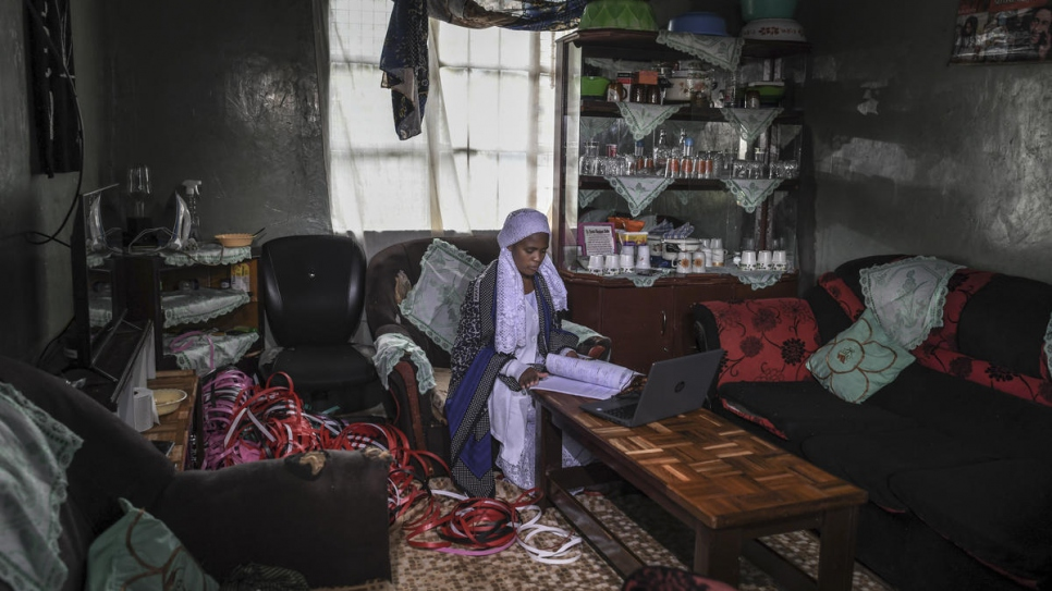 Twenty-year-old stateless Shona woman, Nosizi Reuben, revises on her laptop at home in Kinoo, Kenya.