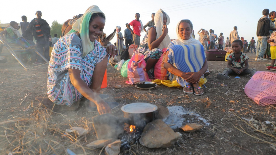 Ethiopian refugees prepare food over an open fire in Hamdayet, Sudan.