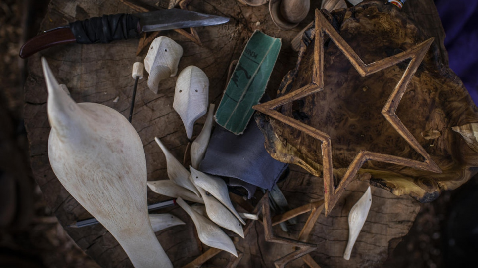 A collection of carvings and tools in the workshop of refugee and artisan Kapya Kitungwa.