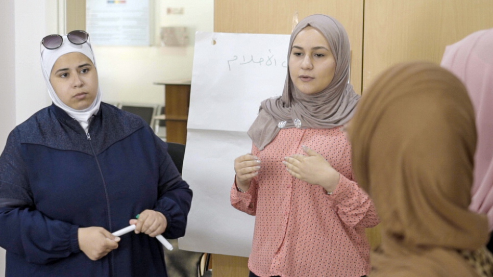 Syrian refugees, Nabila Berm (left) and Sura Al Azami, brainstorm ideas on tackling gender-based violence with the community youth group they founded in Amman, Jordan.