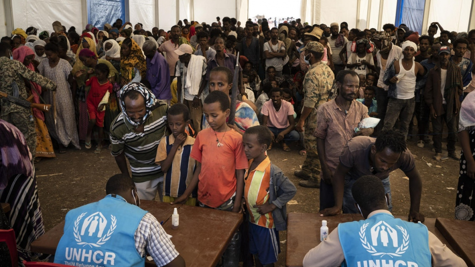 Ethiopian refugees wait to be registered at Hamdayet reception centre in Sudan.