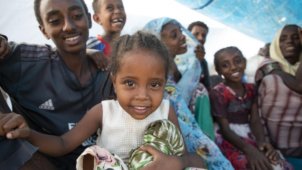 A group of young refugees from the Tigray region of Ethiopia sit in a makeshift shelter at the Hamdayet Border Reception Centre in eastern Sudan.