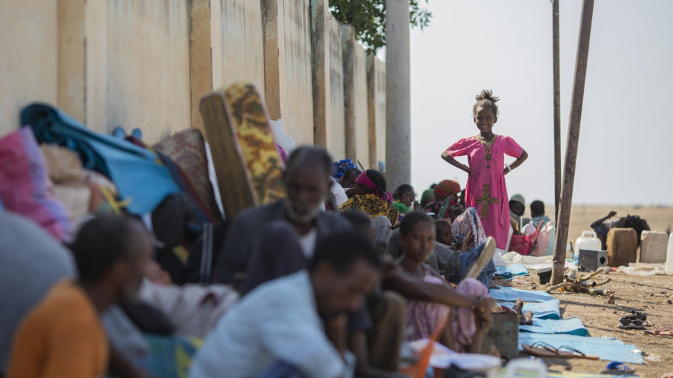 Refugees from Ethiopia sit in the shade to avoid the hot afternoon sun at the Hamdayet Border Reception Centre in eastern Sudan.