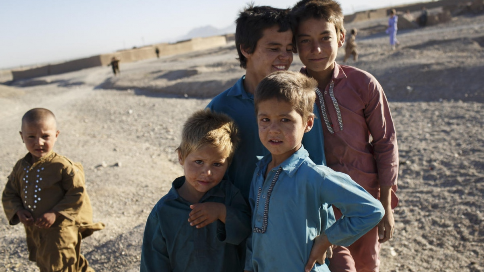 Children play at an informal settlement for internally displaced people on the outskirts of Herat City, Afghanistan.