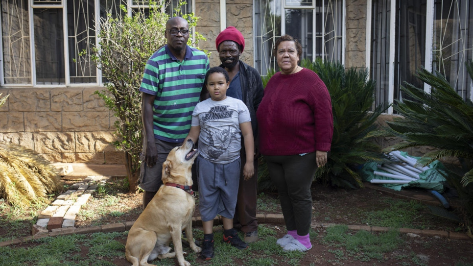 Raphael Chauke (centre), poses with the family that hires him as a gardener in the outskirts of Pretoria, South Africa.