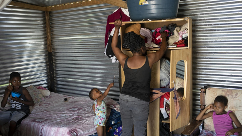 Mpho Modise tidies up the one room she shares with her four children in Brits, South Africa. She lacks identity papers as her birth was never registered.