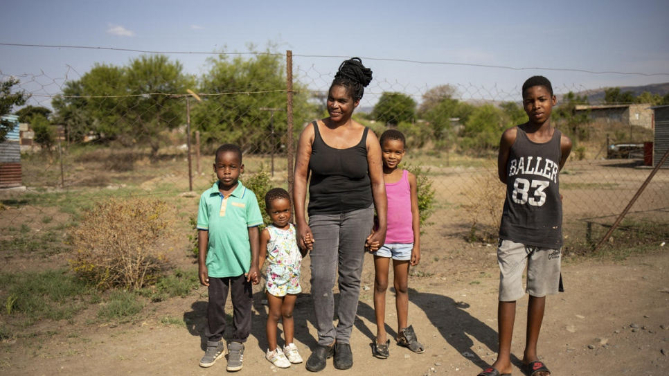Mpho Modise poses with her four children Amojelang, Keitumetsi, Thabang and Lucky in the street in their neighbourhood in Brits, South Africa.