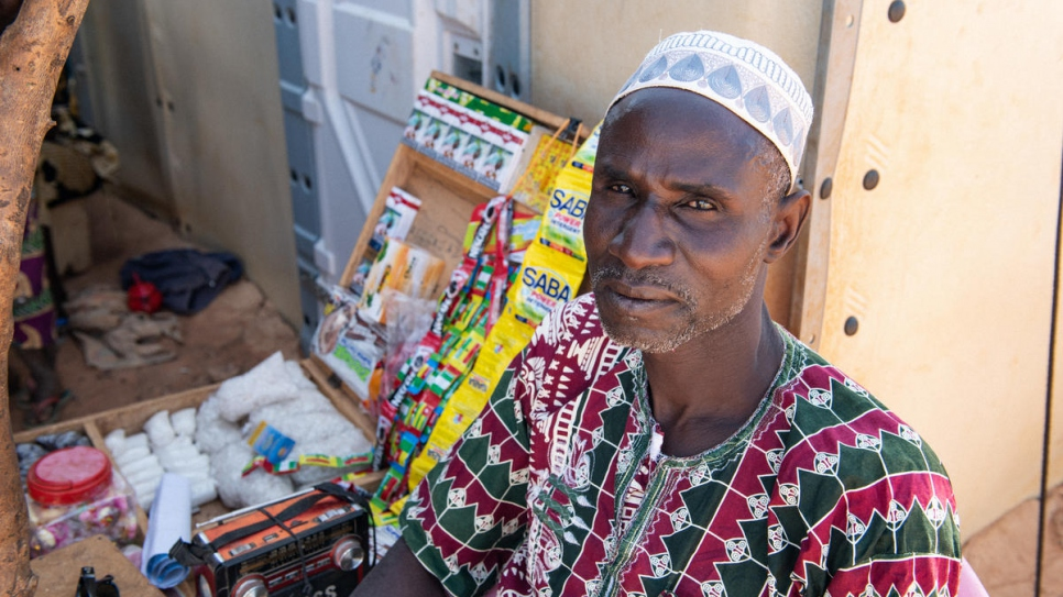 Sambo Maiga sells small items from a stand in front of his shelter in Kongoussi.