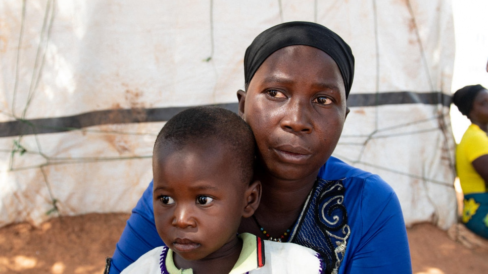 Mamouna Ouédraogo was displaced from her hometown over a year ago. She lives with her mother-in-law and seven children, including one-year-old Alexandre, in Kaya, Burkina Faso.