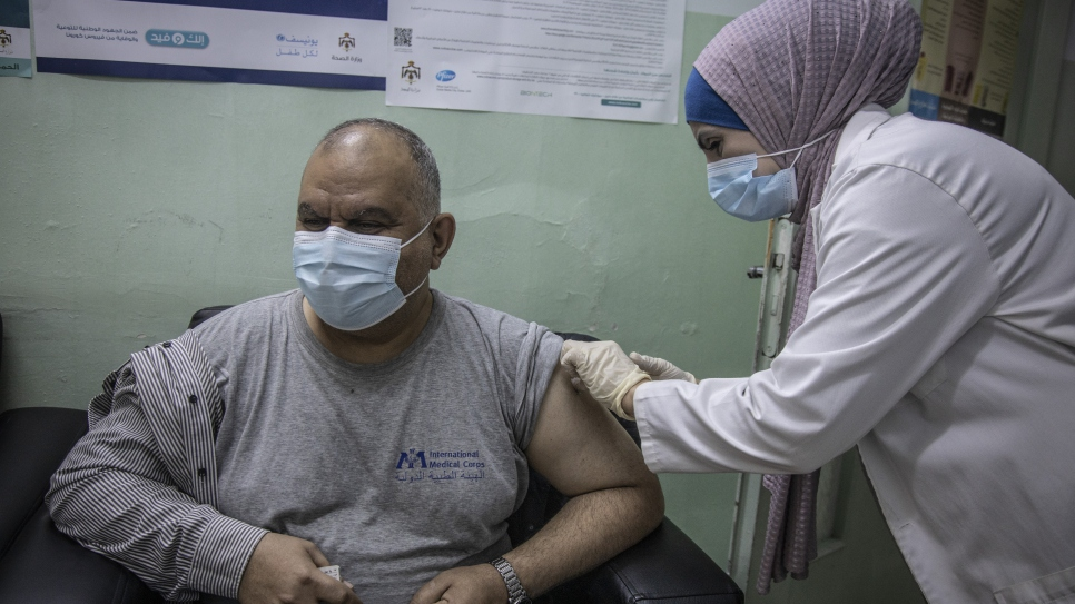 Iraqi refugee Ziad Al Kabashi receives a COVID-19 vaccine at a health centre in Irbid, Jordan.