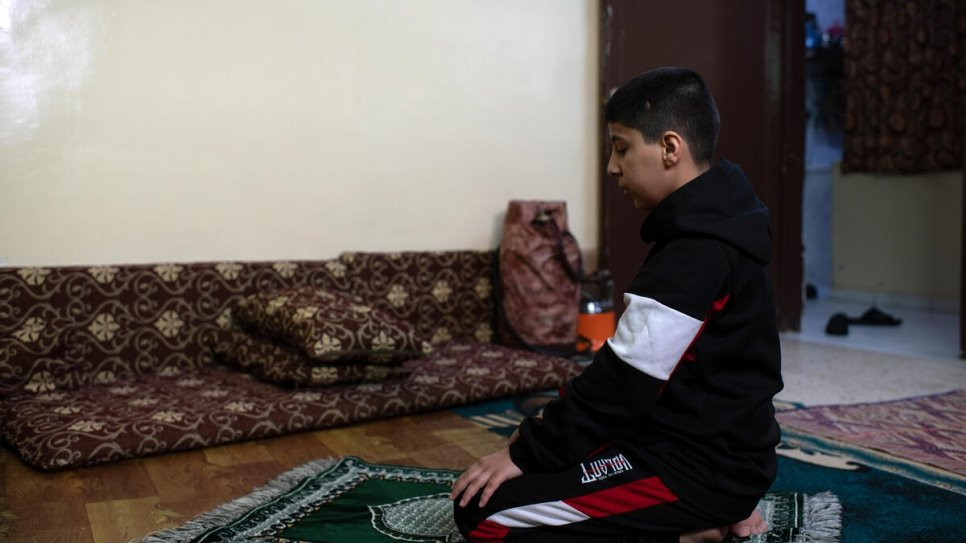 Ali, 12, prays at home ahead of the start of the holy month of Ramadan.