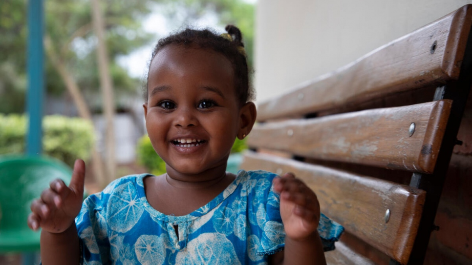 Abdulsabit and Zeinab's eldest daughter is pictured outside their home in Nyamata, Rwanda.
