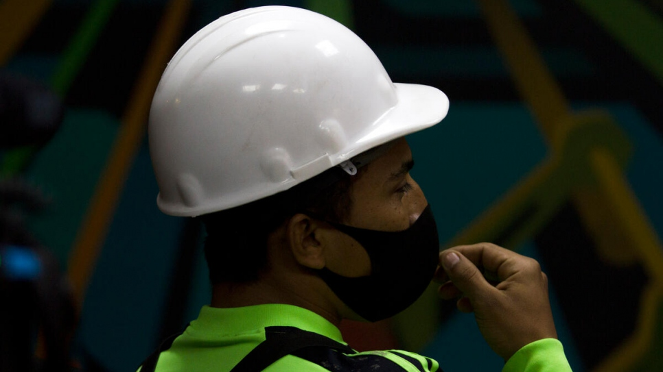 Salvadoran refugee Jorge Gonzalez takes a break during his shift at paper mill GreenPaper in Monterrey, Mexico.