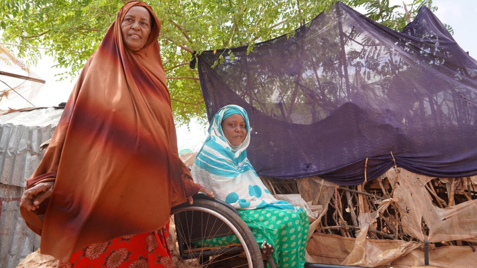 Fatuma Farah (left), a Somali refugee, lives in Buramino camp with her 10 children, two of whom are disabled. The energy cooperative provides her with free clean energy.